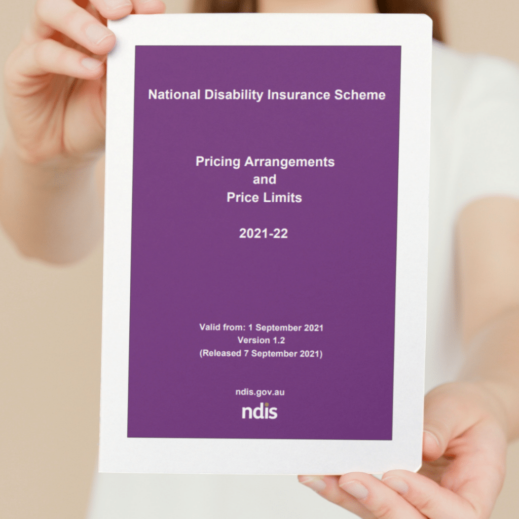 person holding NDIS Pricing Arrangements 2021-2022